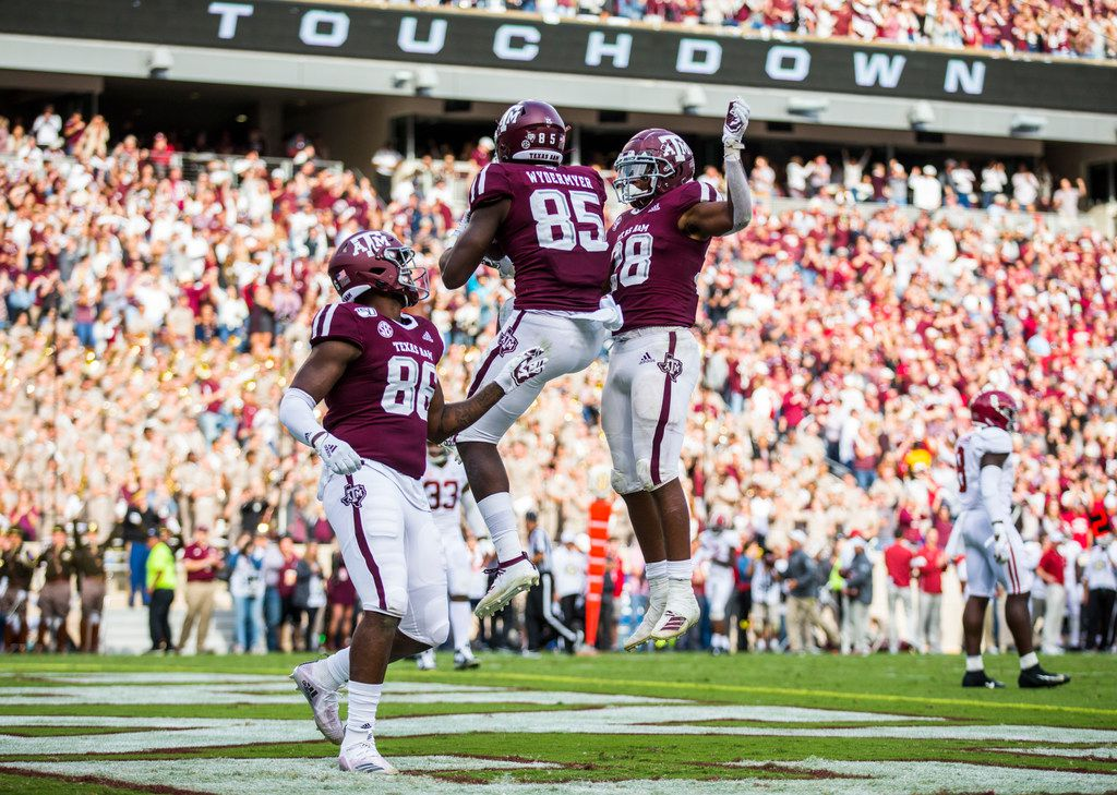 Texas A&M Aggies tight end Jalen Wydermyer (85) celebrates a touchdown with tight end Glenn Beal (86) and running back Isaiah Spiller (28) during the third quarter of a college football game between Texas A&M and Alabama on Saturday, October 12, 2019 at Kyle Field in College Station, Texas.