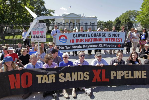 Environmental activists gather outside the White House on Aug. 22, 2011, as they continue a civil disobedience campaign against a proposed oil pipeline from Canada to the U.S. Gulf Coast. The protesters want President Barack Obama to deny a permit for the 1,700-mile Keystone XL pipeline that would take oil extracted from tar sands in Alberta, Canada, and carry it through a pipeline cutting across Montana, South Dakota, Nebraska, Kansas, Oklahoma and Texas to refineries in Houston and Port Arthur.