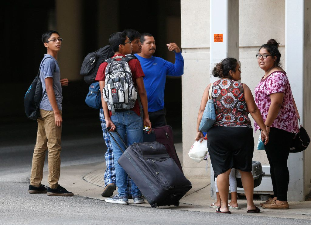 """Evacuees from South Texas arrive at the """"mega shelter"""" outside the Kay Bailey Hutchison Convention Center in Dallas on Tuesday, Aug. 29, 2017."""