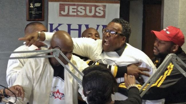 Former Dallas City Council member Dwaine Caraway was held back during the February incident at gospel radio station KHVN-AM.