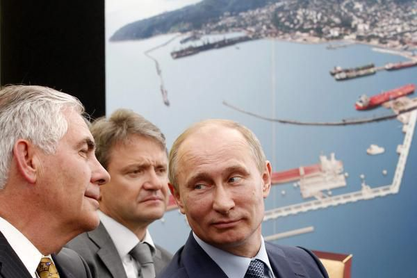 Exxon Mobil Chairman and CEO Rex Tillerson (left) and Russian President Vladimir Putin (right) attended the signing of an agreement between state-controlled Russian oil company Rosneft and Exxon Mobil at a port on the Black Sea in 2012.