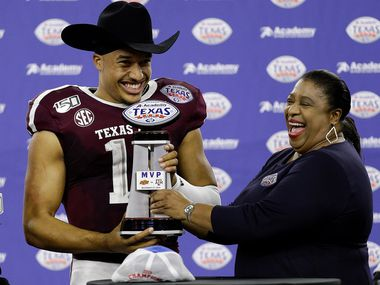 HOUSTON, TEXAS - DECEMBER 27: Kellen Mond #11 of the Texas A&M Aggies receives the MVP trophy as the Texas A&M Aggies defeated the Oklahoma State Cowboys 24-21 during the Academy Sports + Outdoors Texas Bowl at NRG Stadium on December 27, 2019 in Houston, Texas. (Photo by Bob Levey/Getty Images)