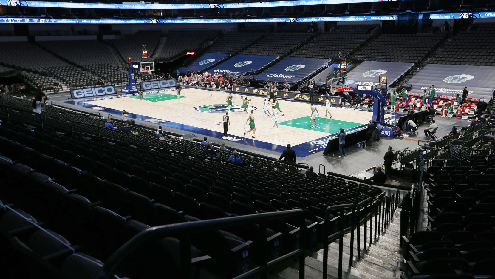 No fans allowed in the arena as the Dallas Mavericks and Charlotte Hornets play in the first quarter of play of the home opener at American Airlines Center on Wednesday, December 30, 2020 in Dallas.