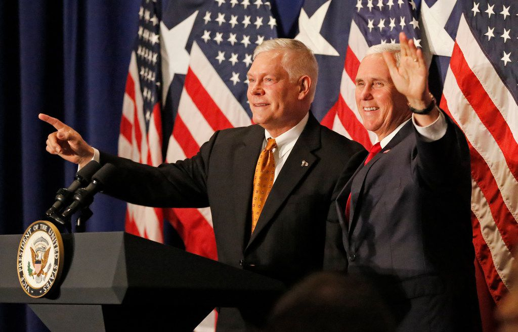 US Vice President Mike Pence, right, and congressman Pete Sessions are pictured together at a rally at the Park Cities Hilton Hotel in Dallas on Monday, October 8, 2018. (Louis DeLuca/The Dallas Morning News)