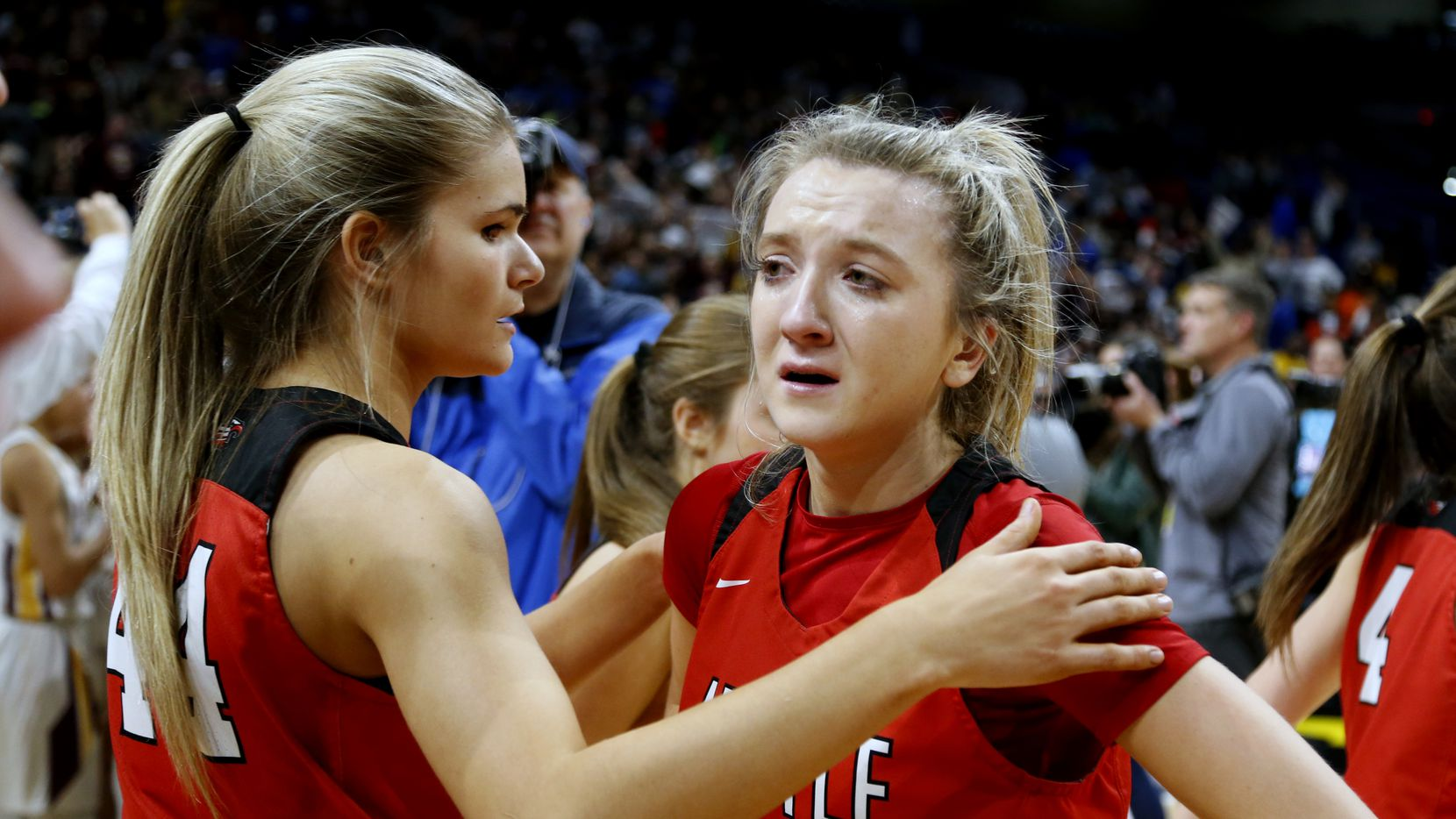 Argyle guard Rhyle McKinney #5 is consoled by Argyle forward Megan Netzelman #44 after Argyle lost in OT in a 4A final on Saturday, March 7, 2020 at the Alamodome.