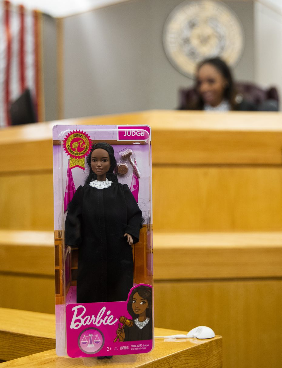 A Judge Barbie doll stands near Dallas County Criminal Court Judge Shequitta Kelly in her courtroom on Monday, November 11, 2019 at Frank Crowley Courts Building in Dallas.