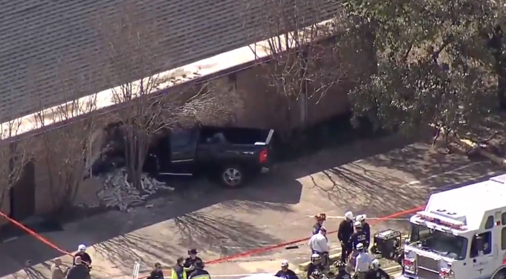 Footage posted online by television stations showed a significant portion of the large black truck wedged into the structure next to the wall's crumbled remains.