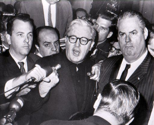Jack Ruby's chief defense attorney, Melvin Belli (center), tells newsmen after the verdict that he will appeal.  Ruby was found guilty of murder and sentenced to death in the electric chair.  Belli charged the state with wanting a verdict regardless of due process.  At right is Belli's assistant, Joe Tonahill.