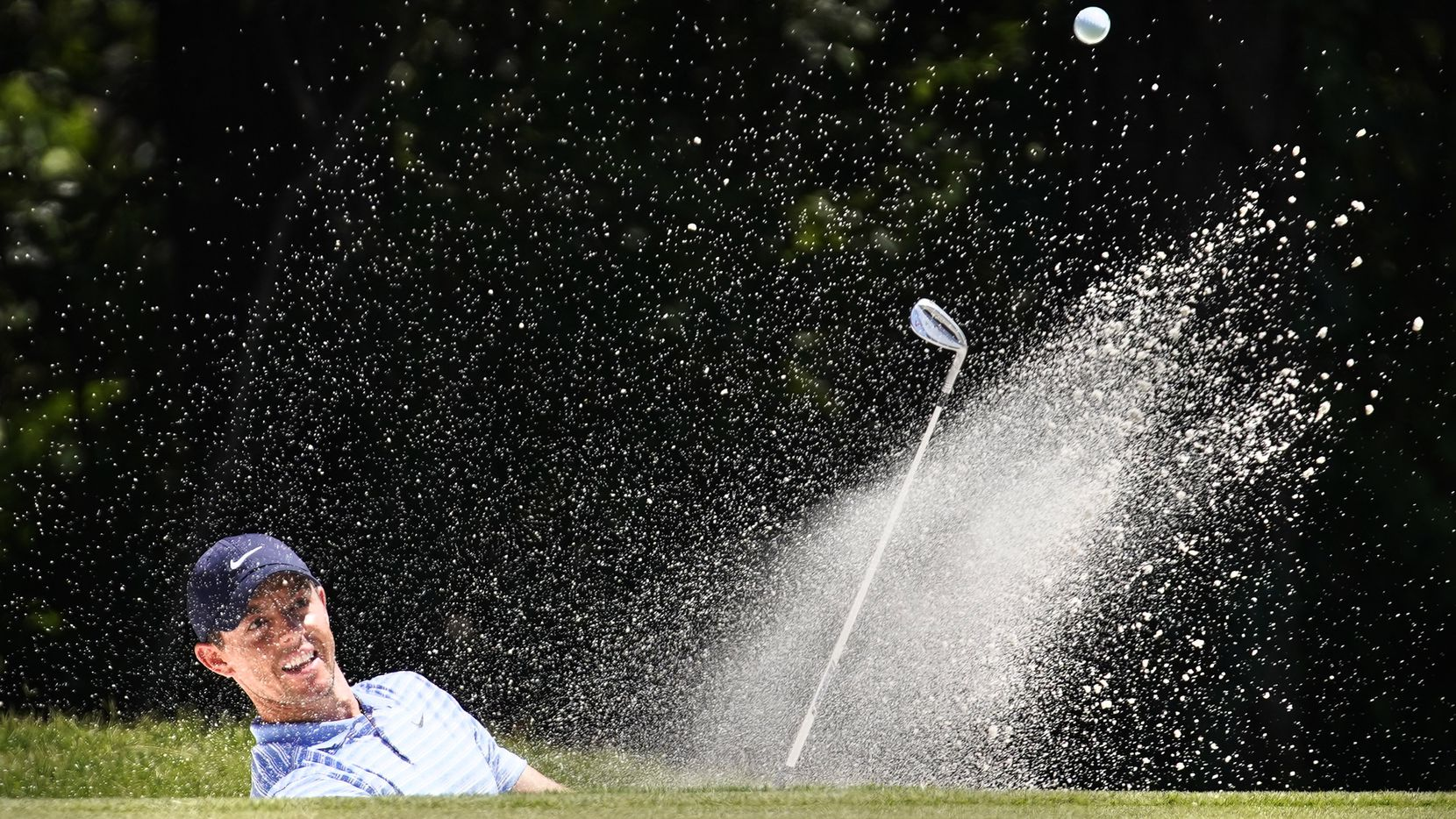 PGA Tour golfer Rory McIlroy hits out of the No. 11 green side bunker during the third round of the Charles Schwab Challenge at the Colonial Country Club in Fort Worth, Saturday, June 13, 2020.  The Challenge is the first tour event since the COVID-19 pandemic began. (Tom Fox/The Dallas Morning News)