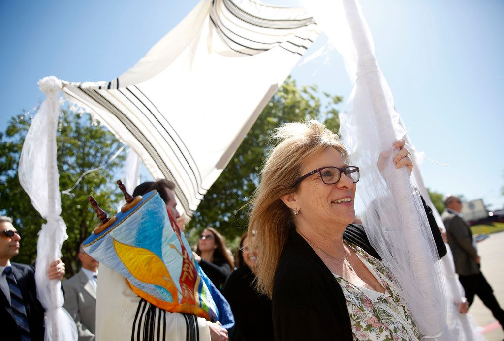 Debbe Katz, sister of Wende Weinberg, helps carry the chupah that covers the torah made specifically for Congregation Anshai Torah on April 15 in Plano. The torah, which was handmade in Israel and took a year to complete, honors Rabbi Stefan Weinberg's wife, Wende, who died of lung cancer in December 2016.