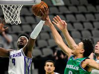 Dallas Mavericks guard Josh Green (8) fights for a rebound against Sacramento Kings guard Terence Davis (9) during the first half of an NBA basketball game at American Airlines Center on Sunday, May 2, 2021, in Dallas.
