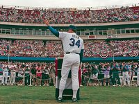 "September 12, 1993: Texas Rangers pitcher Nolan Ryan acknowledges a standing ovation as he addresses the crowd during ""Nolan Ryan Day"" after his final appearance as an active player at Arlington Stadium."