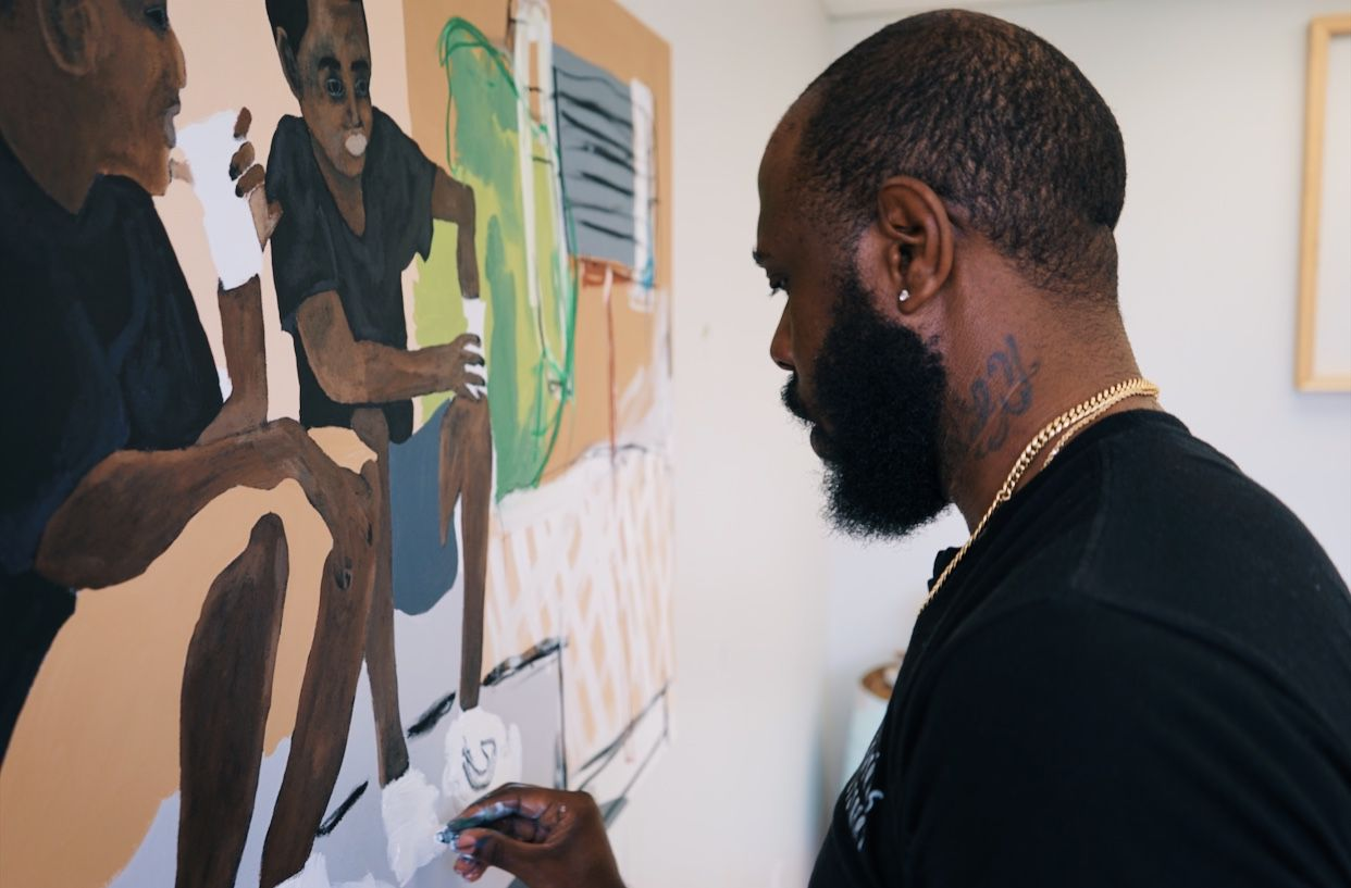 """Jammie Holmes works on the piece """"Frozen cups on narrow streets"""" in his Dallas studio."""