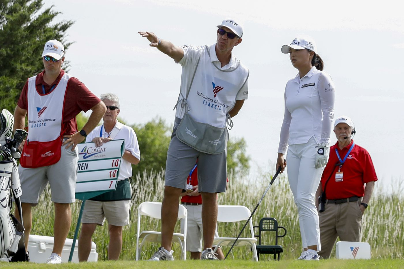 Professional golfer Jin Young Ko (right) talks with her caddie David Brooker prior to hitting off the No. 4 tee box during the third round of the LPGA VOA Classic on Saturday, July 3, 2021, in The Colony, Texas. (Elias Valverde II/The Dallas Morning News)