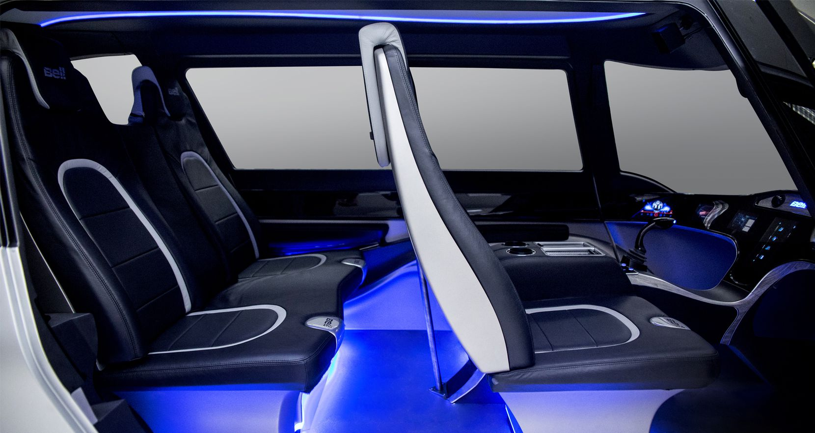 The four-passenger cabin of Bell's air taxi includes leather seats and a display area that could be used for a video conference call.