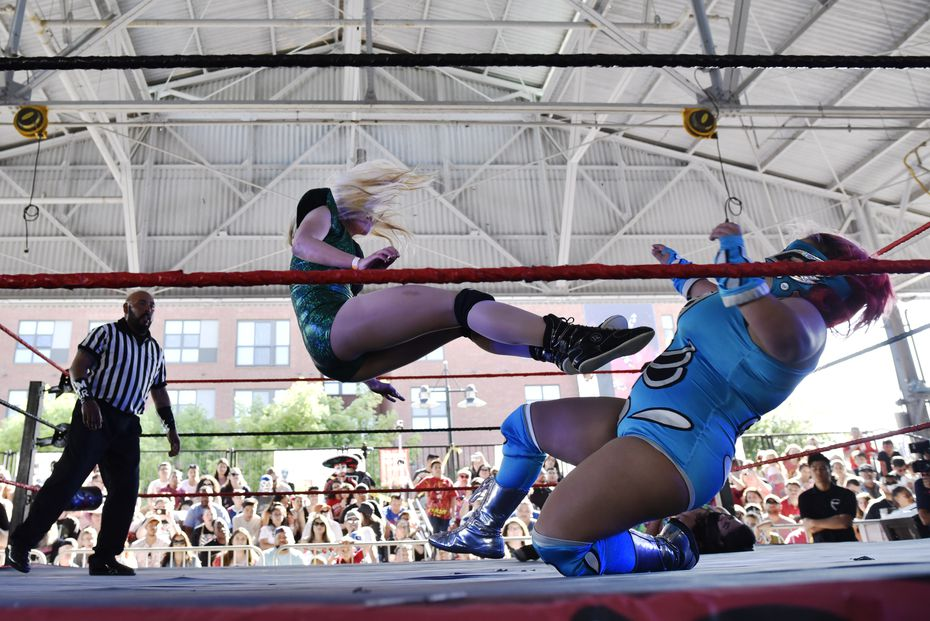 Wrestler Ali Bama, left, flies across the ring as she kicks Dina Mita on her chest during a lucha libre wrestling match at Taco Libre in Dallas in 2019.