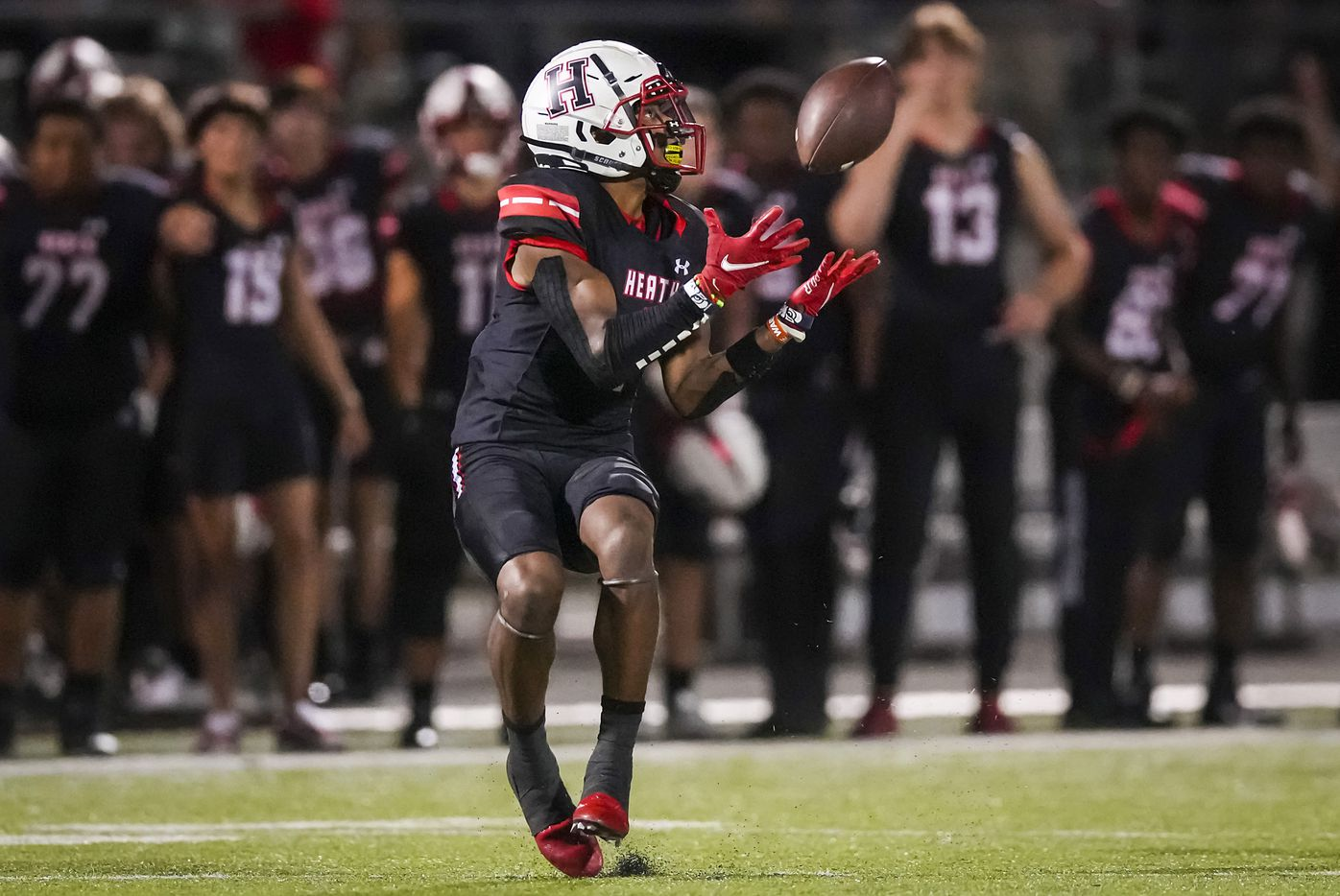 Rockwall-Heath wide receiver Jay Fair (1) hauls in a 69-yard touchdown reception as Rockwall defensive back Will Rkow (24) defends during the first half of a District 10-6A high school football game at Wilkerson-Sanders Stadium on Friday, Sept. 24, 2021, in Rockwall.