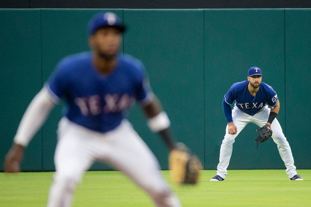 Texas Rangers center fielder Joey Gallo (right) takes his position behind shortstop Jurickson Profar during the second inning against the Houston Astros at Globe Life Park on Thursday, June 7, 2018, in Arlington. (Smiley N. Pool/The Dallas Morning News)