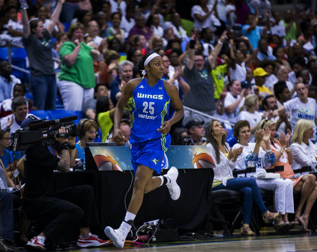 Dallas Wings forward Glory Johnson (25) runs across the court as fans cheer after she scored a point during the fourth quarter of their game against the Phoenix Mercury on Tuesday, June 21, 2016 at the University of Texas at Arlington's College Park Center in Arlington, Texas. The Dallas Wings won 100-90. (Ashley Landis/The Dallas Morning News)