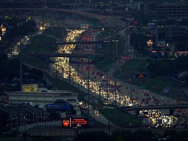 Aerial view of traffic headed eastbound on I-635, Lyndon B. Johnson Freeway, near Skillman Street as night falls on Wednesday, Sept. 16, 2020, in Dallas. (Smiley N. Pool/The Dallas Morning News)