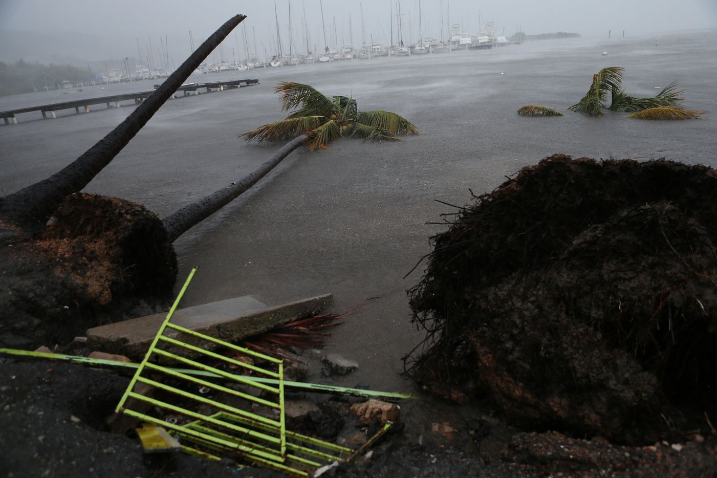 Debris is seen during a storm surge near the Puerto Chico Harbor during the passing of Hurricane Irma on Wednesday in Fajardo, Puerto Rico.