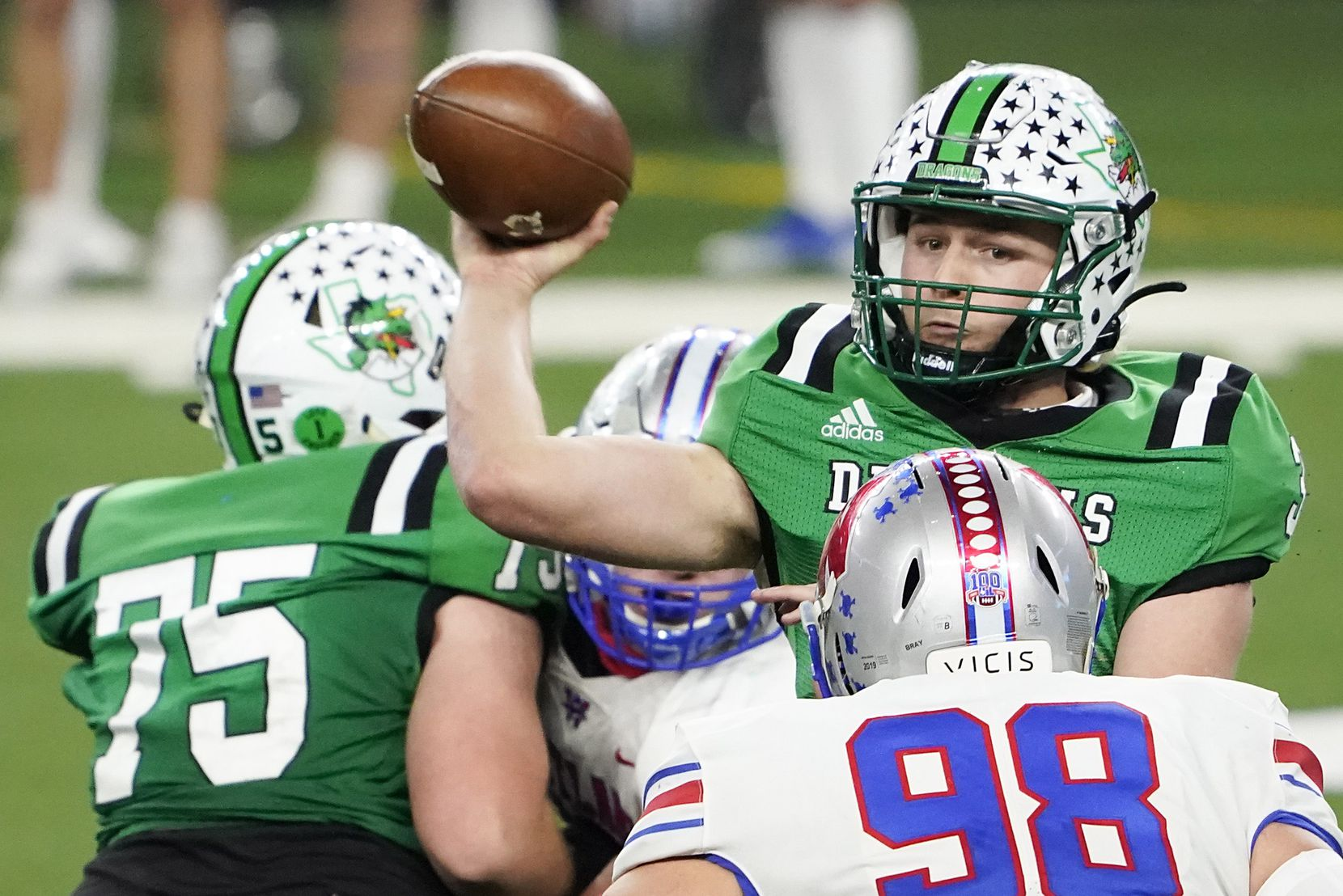 Southlake Carroll quarterback Quinn Ewers (3) throws a pass under pressure from Austin Westlake defensive lineman Haden Bray (98) during the fourth quarter of the Class 6A Division I state football championship game at AT&T Stadium on Saturday, Jan. 16, 2021, in Arlington, Texas. Westlake won the game 52-34.
