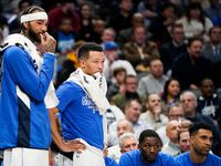 Dallas Mavericks center Willie Cauley-Stein (left) and guard Jalen Brunson watch from the bench during the second half of an NBA basketball game against the Memphis Grizzlies at American Airlines Center on Wednesday, Feb. 5, 2020, in Dallas. (Smiley N. Pool/The Dallas Morning News)