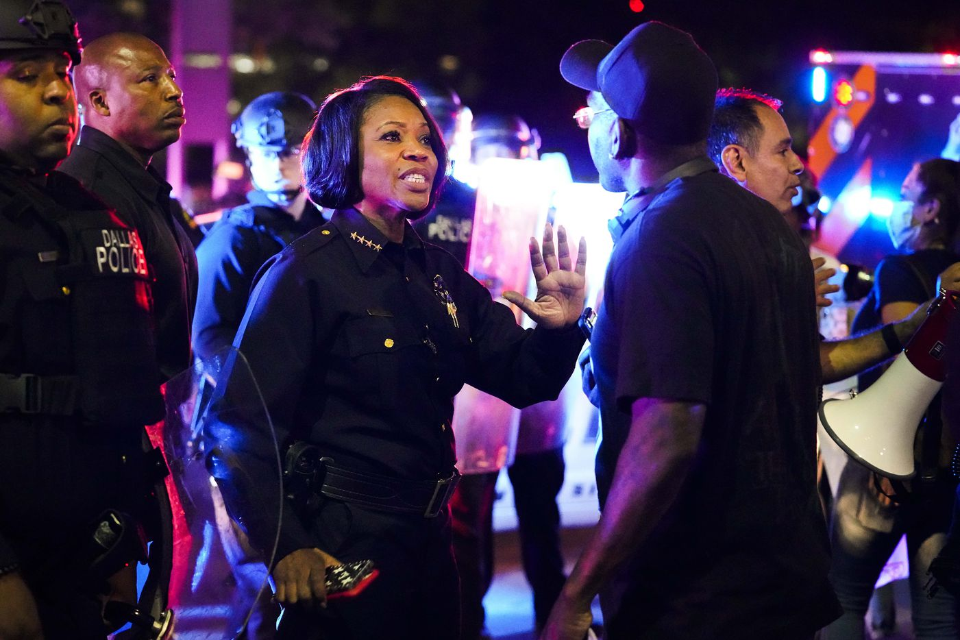 Dallas Police Chief ReneŽ Hall tries to calm a protester at the corner of Griffin and Young Streets as they march against police brutality on Friday, May 29, 2020, in Dallas.