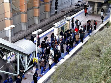 Passengers wait for DART train at Mockingbird Station in Dallas, Texas Problems with overhead power lines temporarily suspended train service in downtown Dallas Tuesday, Nov. 12, 2019 afternoon.The outage near the West End Station affected the Orange, Red, Blue and Green lines, according to Dallas Area Rapid Transit. (Benjamin Robinson/Staff Photographer)