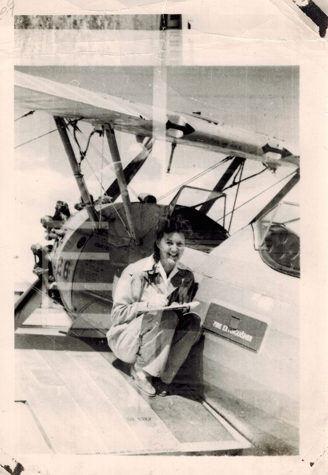 Elaine Harmon pictured in 1944, with a PT-19 plane during WASP training in Sweetwater, Texas. Harmon was a member of the Women Airforce Service Pilots, or WASP, during World War II. On Tuesday, Nov. 13, Harmon's granddaughter Erin Miller will be in Austin to testify against the Texas State Board of Education's decision to eliminate the WASP from the public school social studies curriculum.