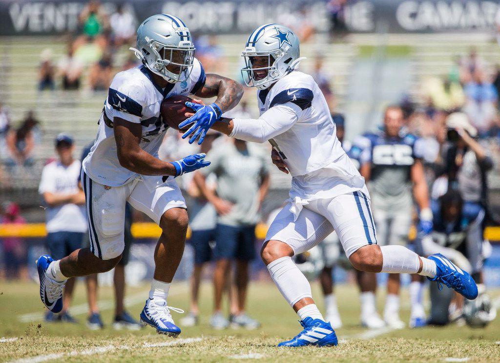 Dallas Cowboys quarterback Dak Prescott (4) hands off the ball to running back Tony Pollard (36) during a morning practice at training camp in Oxnard, California on Thursday, August 8, 2019. (Ashley Landis/The Dallas Morning News)