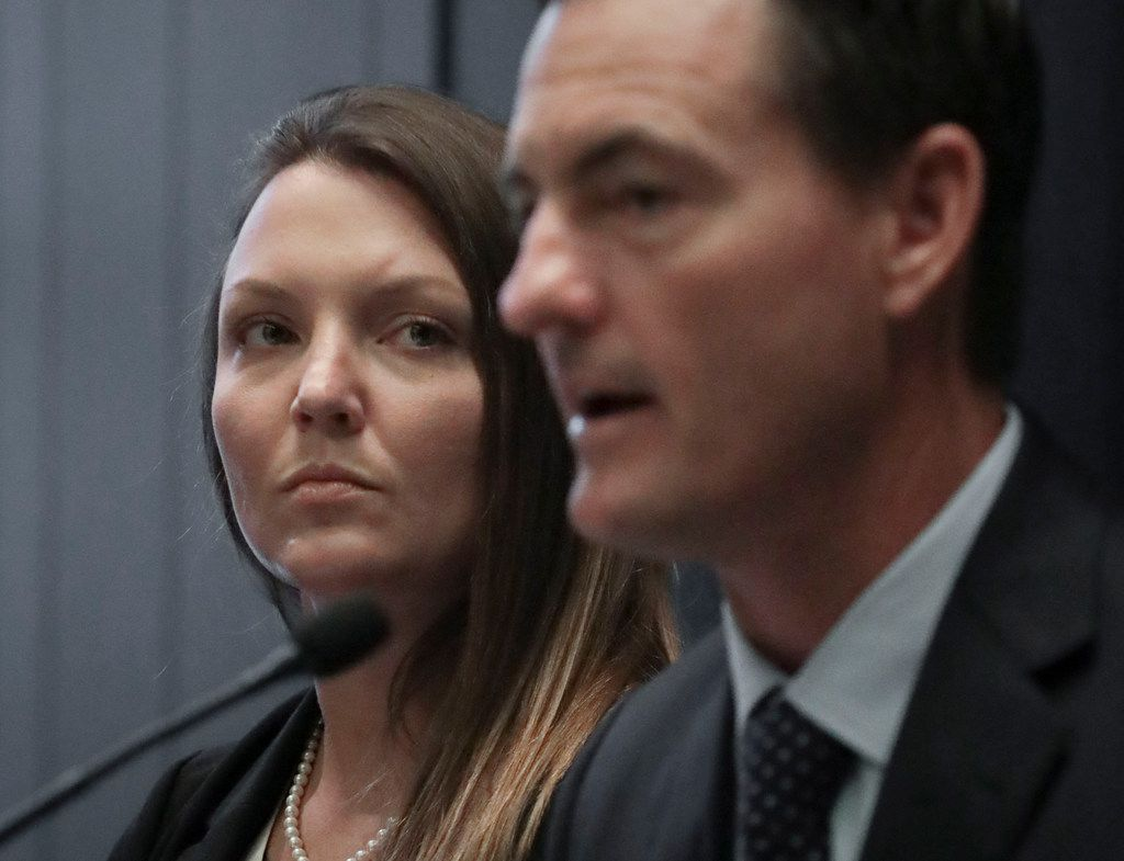 Courtney Wild, left, sexual assault victim of Jeffrey Epstein, listens as her lawyer Brad Edwards speak, during a press conference where she called on other potential victims of Epstein to contact the FBI or lawyers with their information, Tuesday July 16, 2019, in New York.