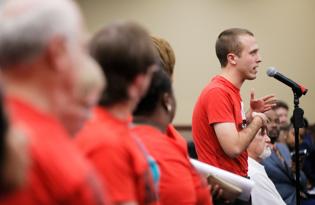 Isaac Davis, a member of the North Texas Democratic Socialists, speaks in favor of a 3 percent raise for Dallas ISD support staff (custodians, office   assistants, cafeteria workers, etc.) during a board of trustees meeting on Aug. 23, 2018.