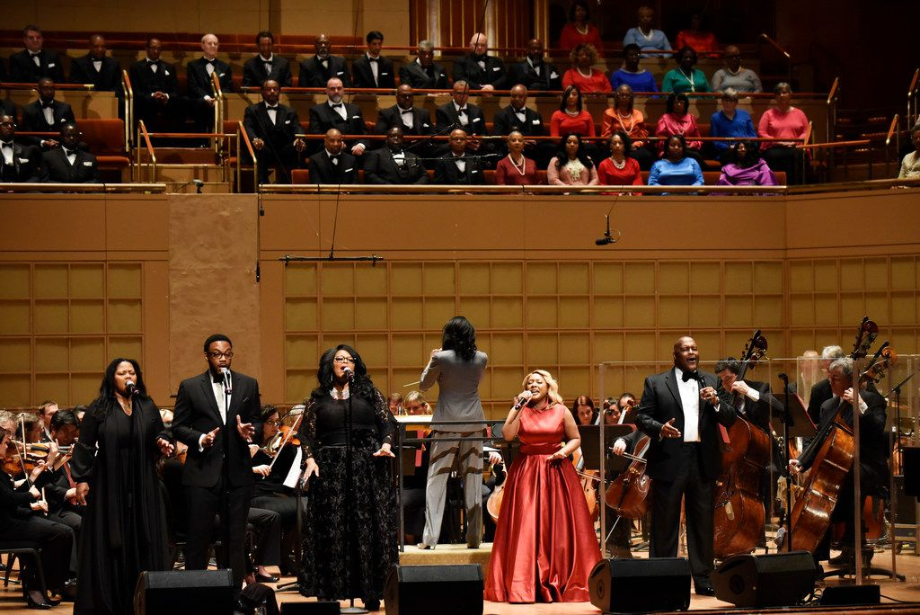 Singer DeShonda Rideout (right) and Marvin Winans (far-right) sing with the Dallas Symphony Orchestra during a performance of Gospel Goes Classical, on Feb. 7, 2019 at the Morton H. Meyerson Symphony Center in Dallas.