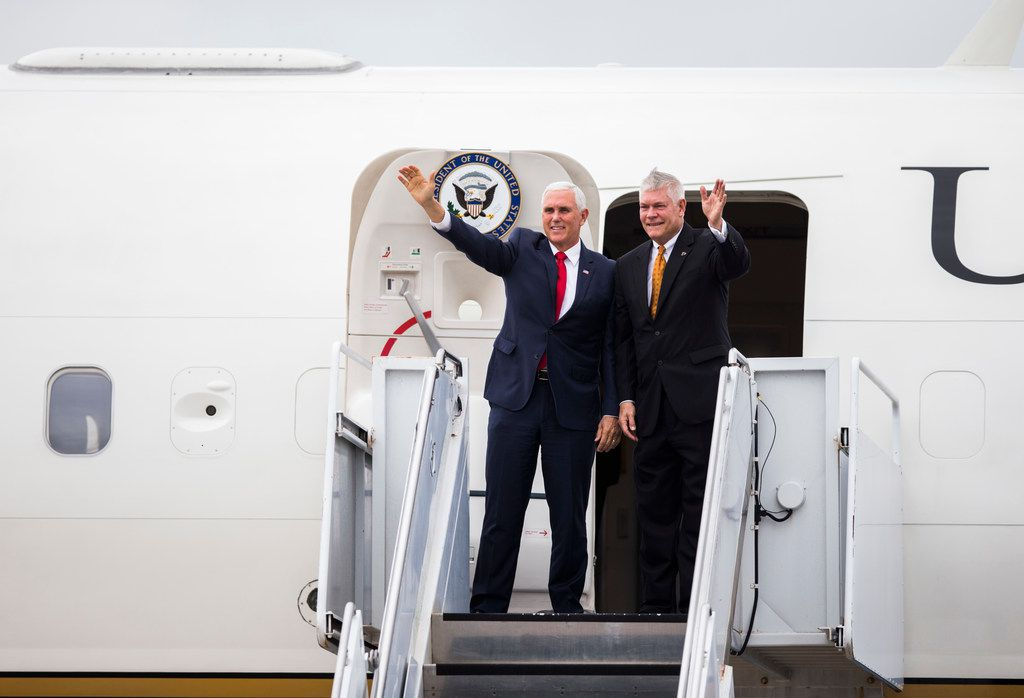 Vice President Mike Pence exits Air Force Two with U.S. Representative Pete Sessions after arriving in Dallas on Monday, October 8, at Love Field Airport in Dallas. Pence will attend a Pete Sessions for Congress event and a Ted Cruz for Senate event before flying to Missouri later today. (Ashley Landis/The Dallas Morning News)