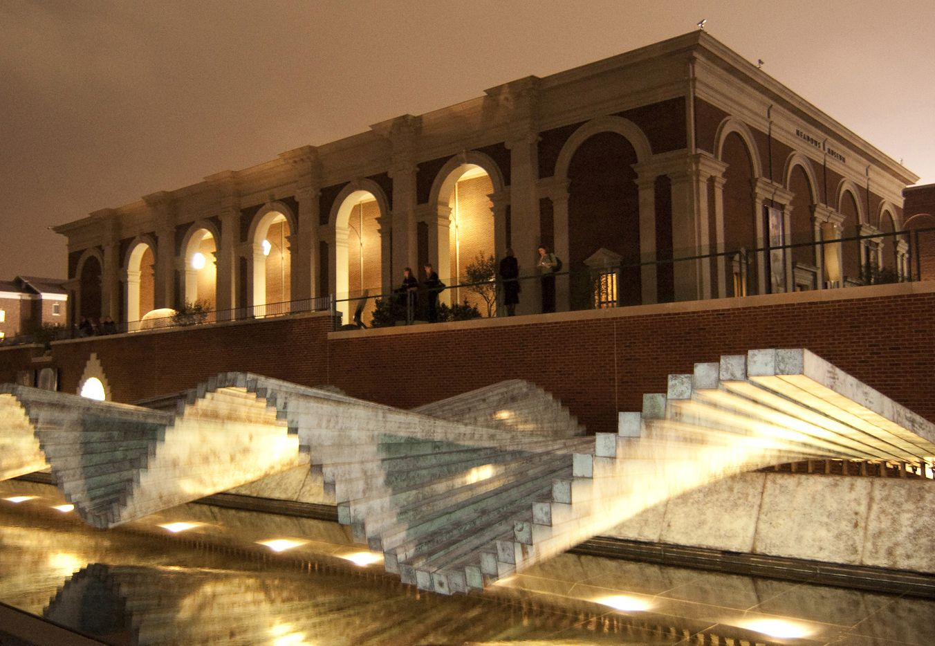 Meadows Museum entrance at night with the Irwin Overlook and Santiago Calatrava's Wave (2002) in foreground.