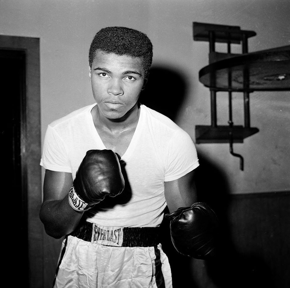 FILE - In this Feb. 8, 1962, file photo, young fighter Cassius Clay (Muhammad Ali) is seen at City Parks Gym in New York.  Ali, the magnificent heavyweight champion whose fast fists and irrepressible personality transcended sports and captivated the world, has died according to a statement released by his family Friday, June 3, 2016. He was 74. (AP Photo/Dan Grossi, File)