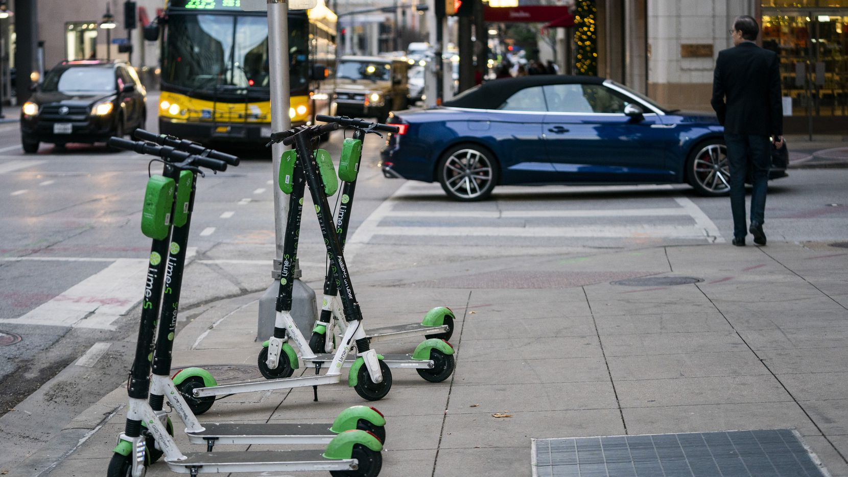Lime electric scooters sat on the sidewalk on Commerce Street in downtown Dallas on Dec. 4, 2019. City officials halted the program due to public safety concerns. The scooters are expected to return later this month after new rules are added.