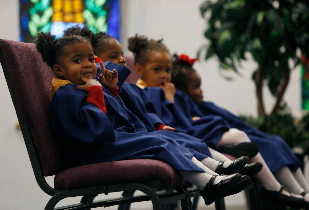Pre-kindergartner Maliah Sadler sat on stage with other acolytes during a Valentine's Day service at St. Philip's School and Community Center in Dallas on Feb. 14. (Rose Baca/The Dallas Morning News)
