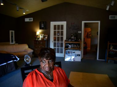 In this 2015 file photo, Donna Tusan sits in son Terrence Tusan's bedroom at her home in Arlington. After losing both of her sons to violence, Donna and her ex-husband started a foundation that supports young people with scholarships and mentoring.