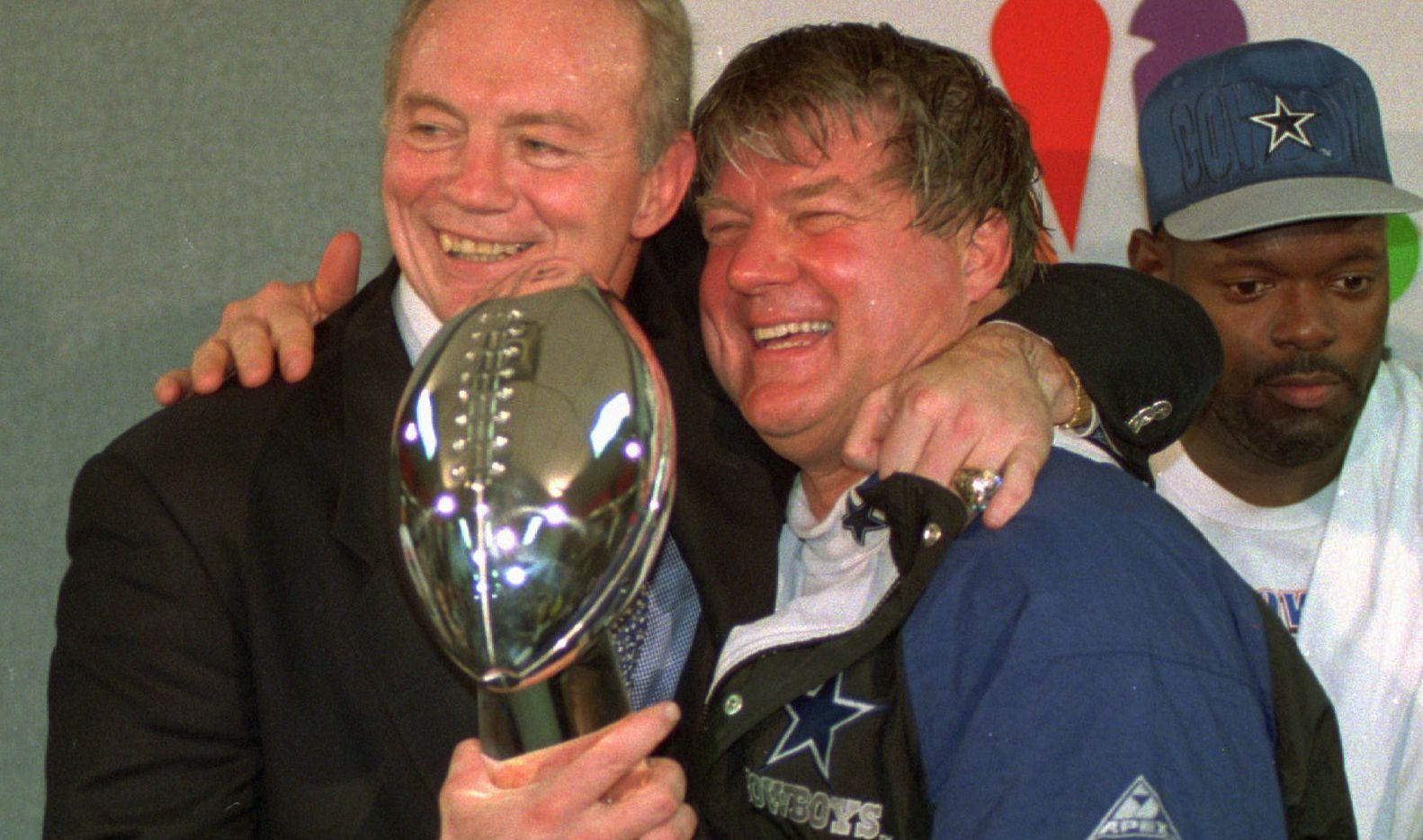 FILE - In this Jan. 30, 1994 file photo, Dallas Cowboys owner Jerry Jones, left, and coach Jimmy Johnson celebrate with the Vince Lombardi trophy after defeating the Buffalo Bills 30-13 in  Super Bowl XXVIII at the Georgia Dome in Atlanta. (AP Photo/Charles Krupa, File)