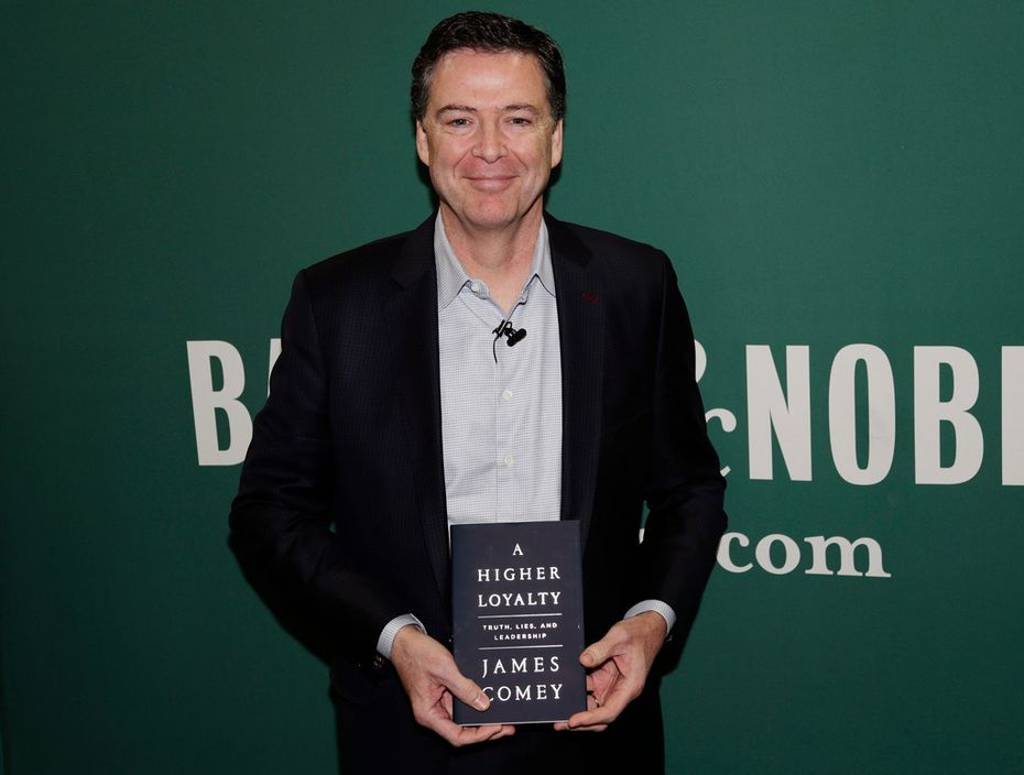 Former FBI Director James Comey poses for photographs at a Barnes & Noble book store before speaking Wednesday.