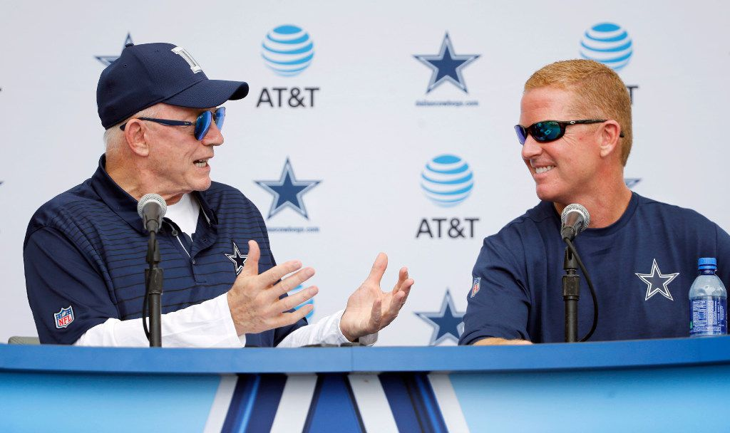 FILE - Dallas Cowboys owner and general manager Jerry Jones looks at Dallas Cowboys head coach Jason Garrett as he tells a story during a press conference in Oxnard, Calif., on Sunday, July 23, 2017. (Vernon Bryant/The Dallas Morning News)