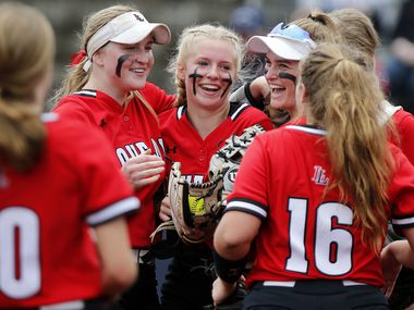 Lovejoy pitcher Jade Owens (center) is congratulated by her team after getting out of a jam in the sixth inning as Lovejoy High School played Wakeland High School in final game of a best of three playoff for District 5A bi-district at McKinney Boyd High School in McKinney on Saturday, May 1, 2021. (Stewart F. House/Special Contributor)