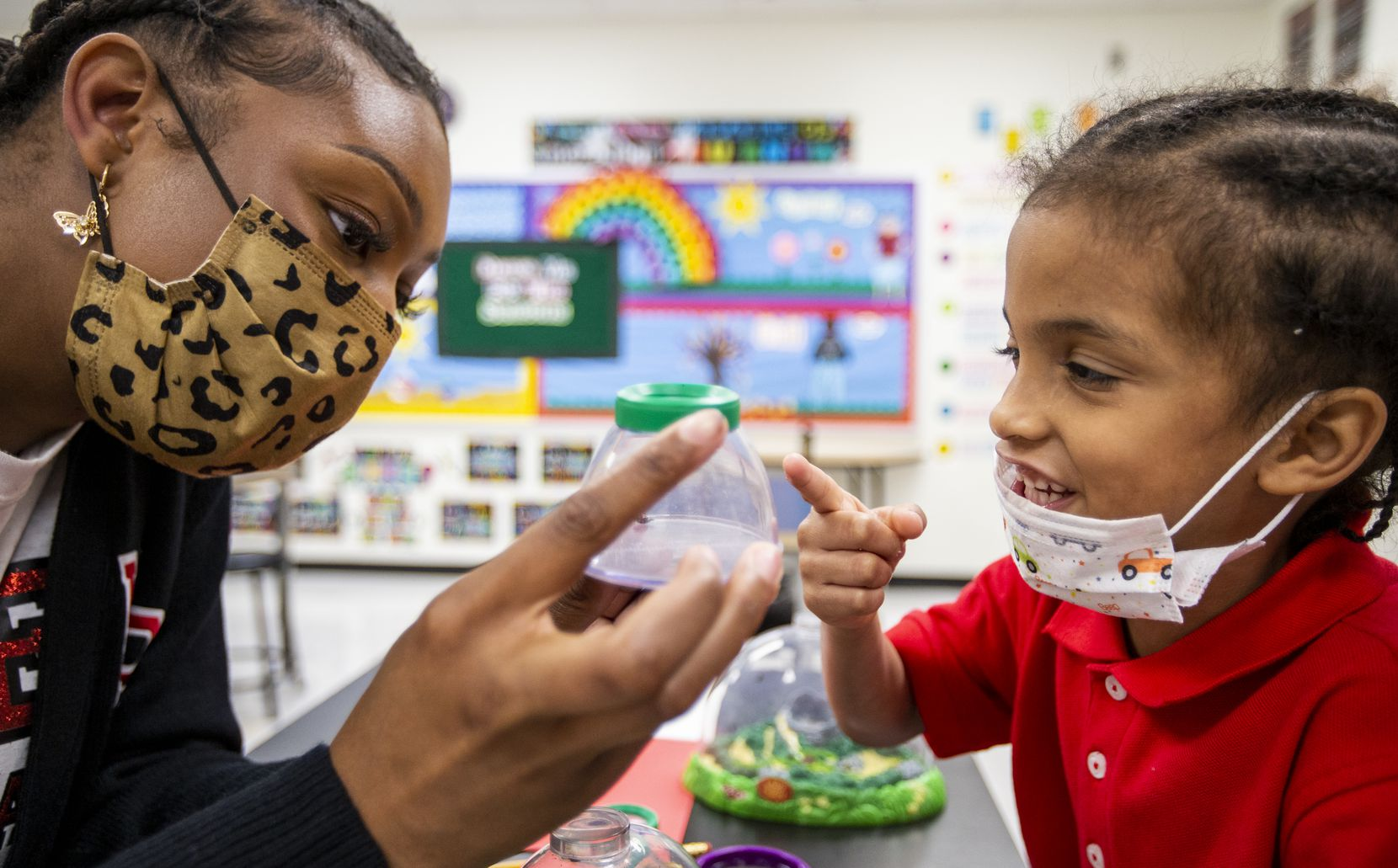 Prekindergarten assistant teacher Alexis Alexander shows Prosper Gilkey a closeup view of a ladybug during a pre-K through second grade science lab at High Pointe Elementary School in Cedar Hill last month. In the lab students learn age-specific science lessons. (Brandon Wade/Special Contributor)