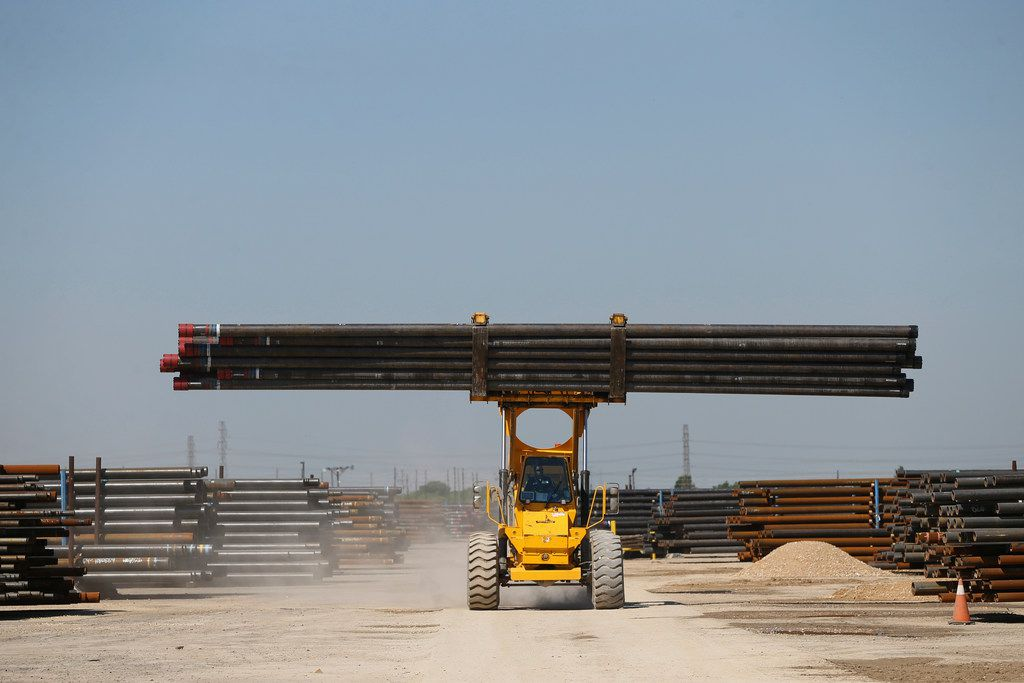 """Borusan Mannesmann Pipe U.S.'s chief executive Joel Johnson said his customers were """"frantic"""" when the tariffs were announced. Here, a forklift moves steel pipes at the Borusan Mannesmann plant in Baytown."""