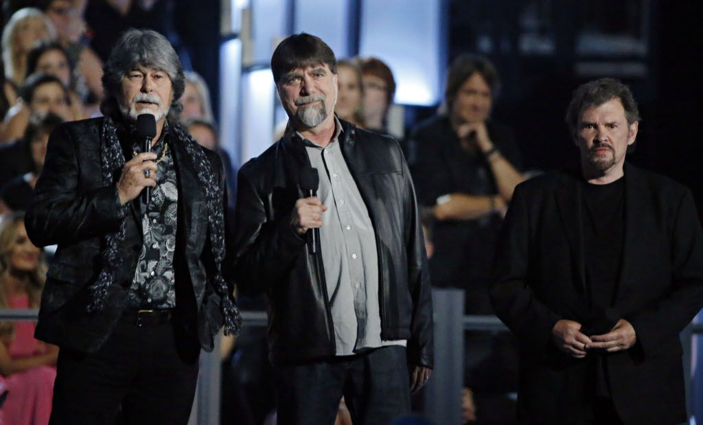 Members of the band Alabama introduce Vocal Group of the Year during the 2015 Academy of Country Music Awards Sunday, April 19, 2015 at AT&T Stadium in Arlington, Texas.