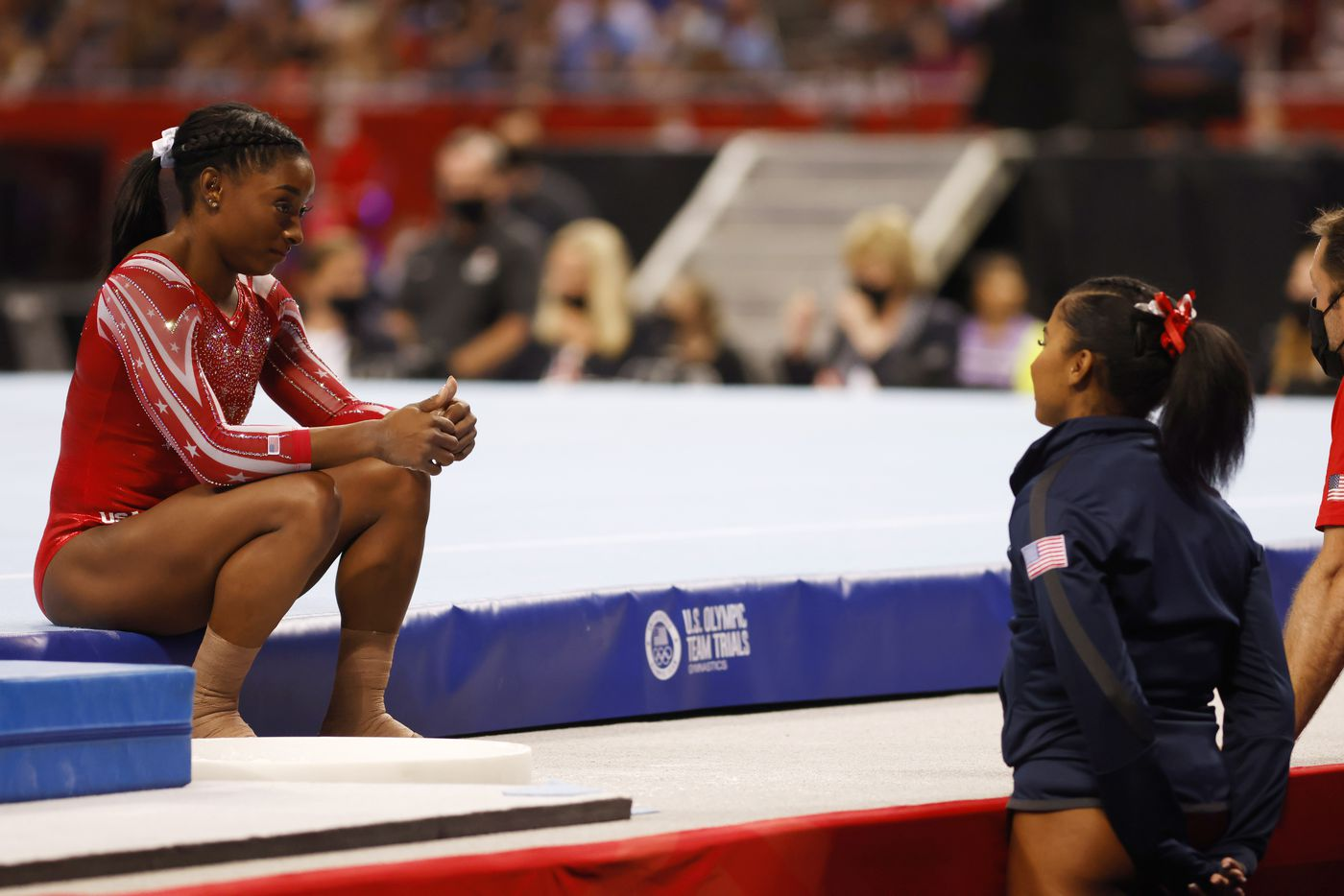 Simone Biles talks with Jordan Chiles before competing on the floor during day 2 of the women's 2021 U.S. Olympic Trials at The Dome at America's Center on Saturday, June 27, 2021 in St Louis, Missouri.(Vernon Bryant/The Dallas Morning News)