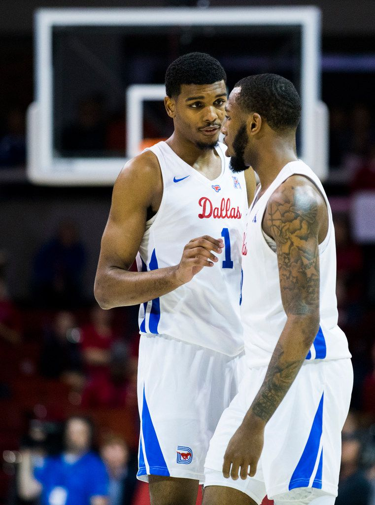 Southern Methodist Mustangs forward Feron Hunt (1) talks with guard Tyson Jolly (0) during overtime of a basketball game between SMU and University of Houston on Saturday, February 15, 2020 at Moody Coliseum in Dallas. (Ashley Landis/The Dallas Morning News)