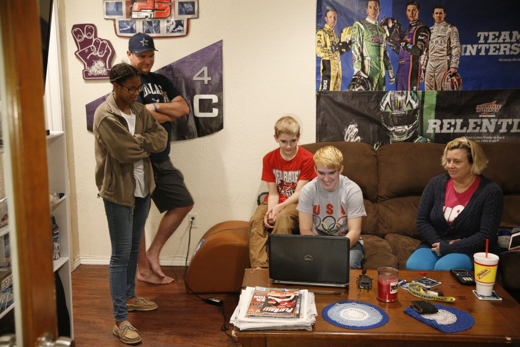 Mack Beggs (in front of computer) state wrestling champion and 17-year-old transgender student from Euless Trinity during an interview on Skype with  friend, D'Shaylyn August, 17, (from left) his father, Damon McNew, brother, Harley McNew, 13, and mother Angela McNew, at his home in Hurst, Texas on February 28, 2017.  (Nathan Hunsinger/The Dallas Morning News)